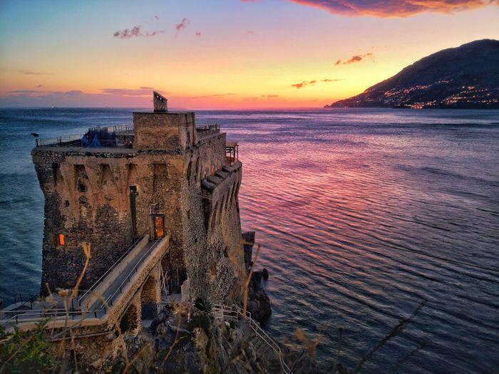 Norman's Tower in Maiori sunset and sea Coastline Coastline Landscape Amalfi Coast Maiori Pink Sunset Winter Sunset Sailing Ship Nautical Vessel Water Sea Sunset Beach History Old-fashioned Dusk Sky