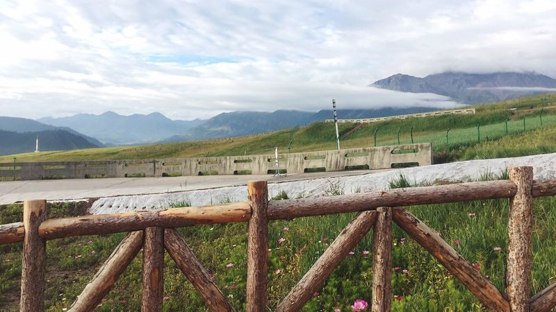 Mountain Mountain Range Sky Wood - Material Beauty In Nature Day Protection Nature No People Cloud - Sky Outdoors Scenics Landscape Grass
