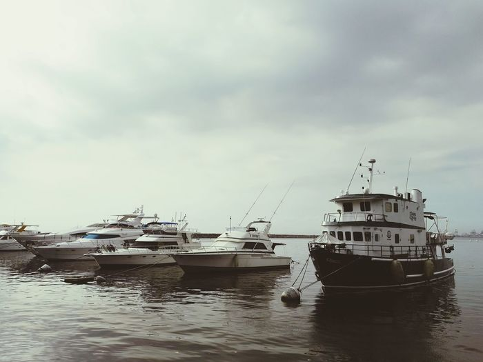 Not a good day to sail Miles Away Nautical Vessel Water Sea Pier Docked Boats Dockyard Boat Cloud - Sky Yatch Transportation Harbor