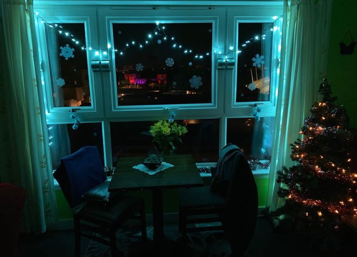 Illuminated Night Table Indoors  Plant Window Business Reflection Furniture Built Structure Decoration No People Lighting Equipment Glass - Material Domestic Room Nightlife Nature Architecture Seat Chair
