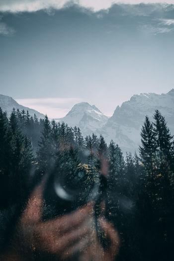 Snowcapped mountains seen through window