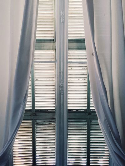 Mediterranean shutters and window, sunlight getting into the room Window Indoors  Curtain Blinds Close-up Day Sunlight Sunny No People White Background Mediterranean  Mediterranean Life Filtered Room Interior Bedroom Bedroom Window Shutters Shutter Inside Home Home Interior Daylight Sunny Day