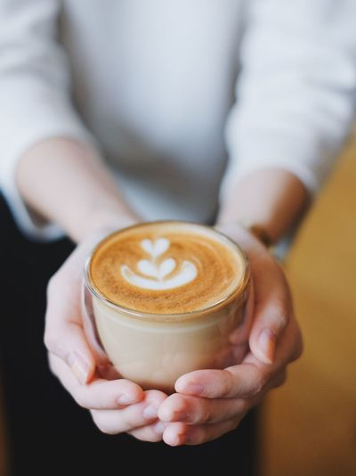 Adult Adults Only Barista Cappuccino Close-up Coffee - Drink Coffee Cup Drink Food And Drink Froth Art Frothy Drink Heat - Temperature Holding Human Body Part Human Hand Latte Midsection One Person One Woman Only Only Women People Refreshment Serving Food And Drinks Women