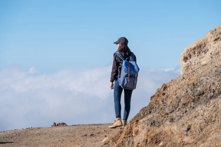 Travel hiking volcano Ijen Undinesia Hiking INDONESIA Adult Backpack Blue Casual Clothing Front View Ijen Leisure Activity Lifestyles Mountain Nature One Person Rock Sky Solid Standing Travel Destinations Trecking Volcano Young Adult Young Women
