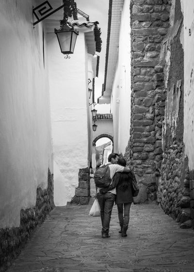 Solitary Moment for Two Love Lovers Alley Architecture Brick Bricks Cobblestone Lifestyles Narrow Rear View Stone Stucco Two People Walking