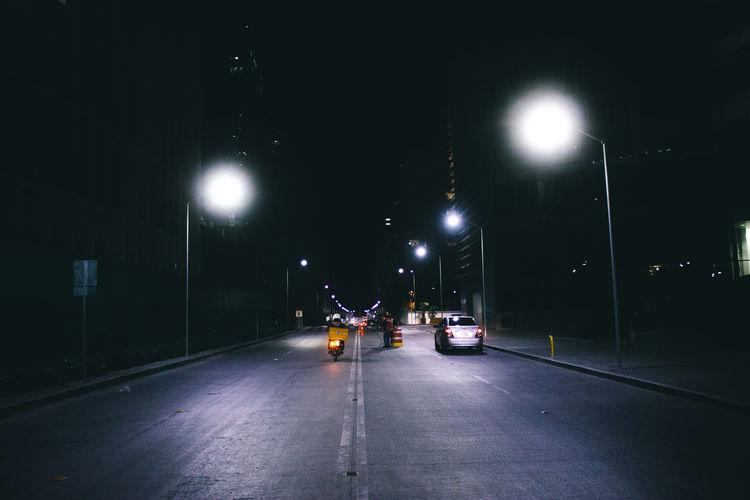 Street at night. Illuminated Night One Person Outdoors People Road Sky Street Street Light Streetphotography Transportation