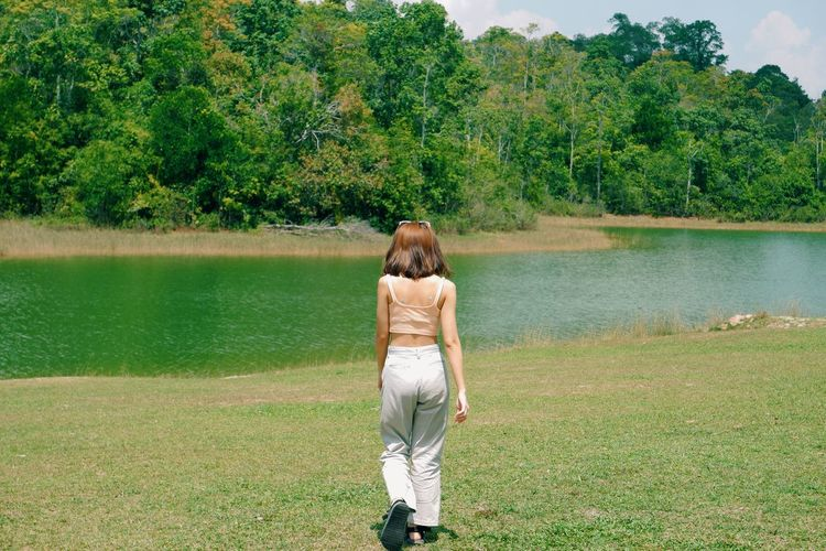 Rear view of woman on shore