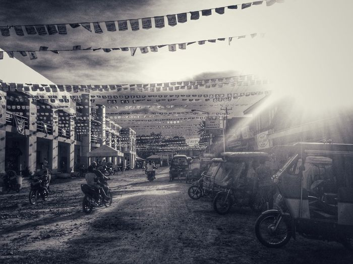 Nostalgia Home Town Home Is Where The Heart Is Rural Scenes At The Province Everything Is Simple Everyday Lives Fiesta Banderitas Late Afternoon Street Photography Everybodystreet Black & White Simple Things In Life Mobile Photography Eyeem Philippines Motorcycles