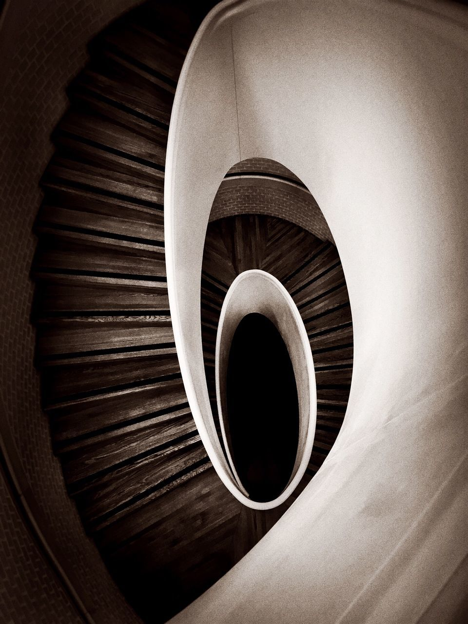 circle, spiral, indoors, high angle view, no people, steps and staircases, staircase, steps, directly above, spiral stairs, close-up, day