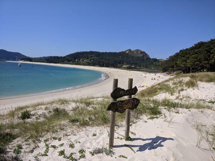 Rodas Beach 🏖 Tree Water Clear Sky Sea Beach Sand Sunny Sky Sand Dune Shore Sandy Beach Ocean Calm Horizon Over Water FootPrint Coastline