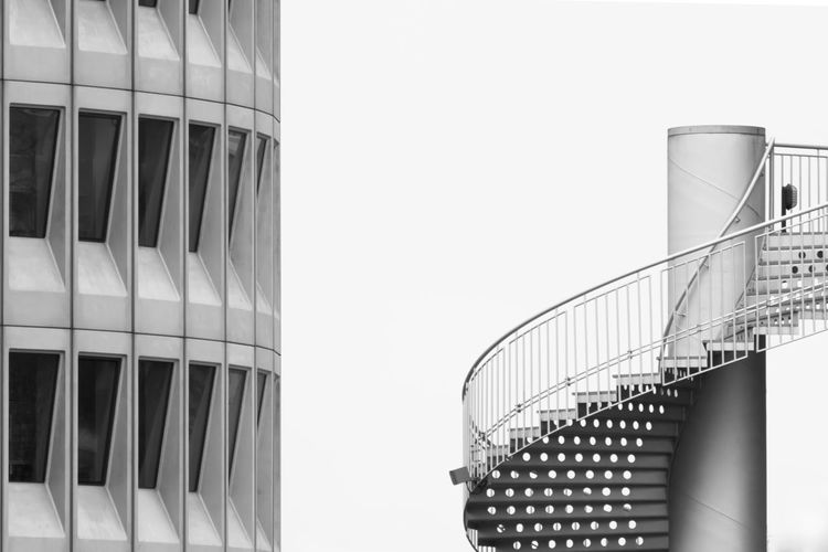 Building And Spiral Staircase Against Clear Sky