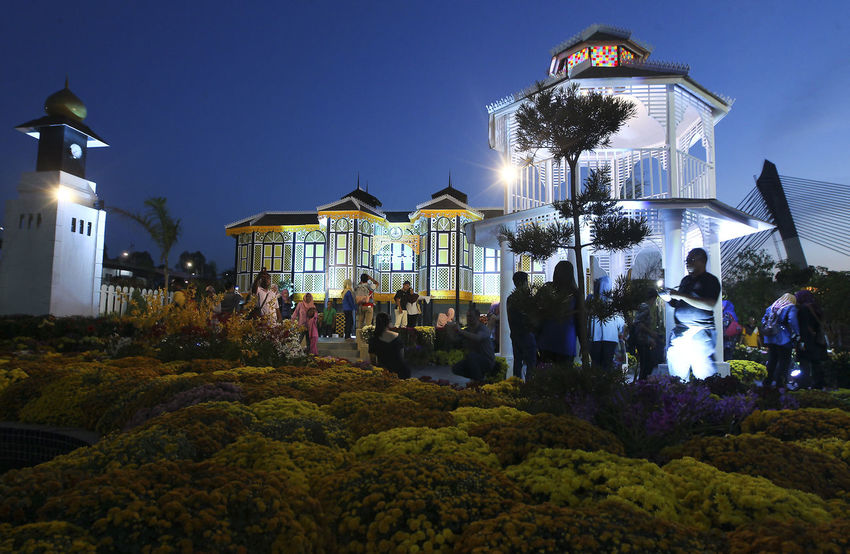 PUTRAJAYA, MALAYSIA : Anjung Flora Event Centre at Presint 4, Putrajaya, on August 25 to 02 September, 2018 Adult Architecture Building Building Exterior Built Structure Clear Sky Crowd Dusk Group Of People Illuminated Large Group Of People Lifestyles Light Lighting Equipment Nature Night Outdoors Plant Real People Sky Women