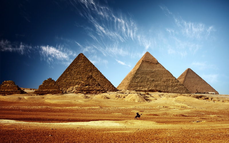 Pyramids at desert against sky