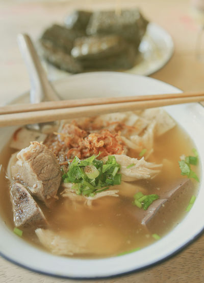 Vietnamese rice noodles soup on wood background. Food Food And Drink Soup Bowl Close-up Table Asian Food Noodle Soup Chinese Food Meat Freshness Meal Hot