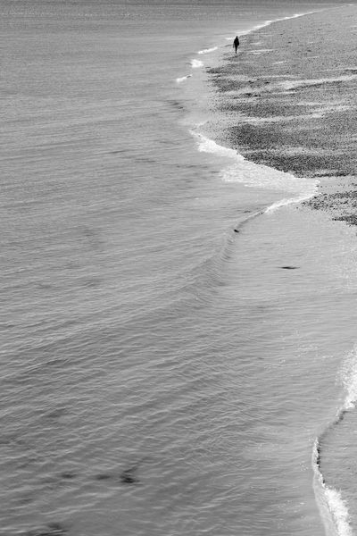 Solitary Walker Beach Beauty In Nature Blackandwhite Day Incidental People Land Motion Nature Outdoors Sand Scenics - Nature Sea Solitude Tranquil Scene Water