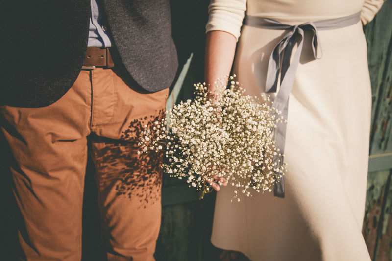 Adult Bonding Bouquet Casual Clothing Couple - Relationship Day Event Flower Flower Arrangement Flowering Plant Holding Lifestyles Love Men Midsection Nature Outdoors People Plant Positive Emotion Real People Standing Togetherness Two People Women