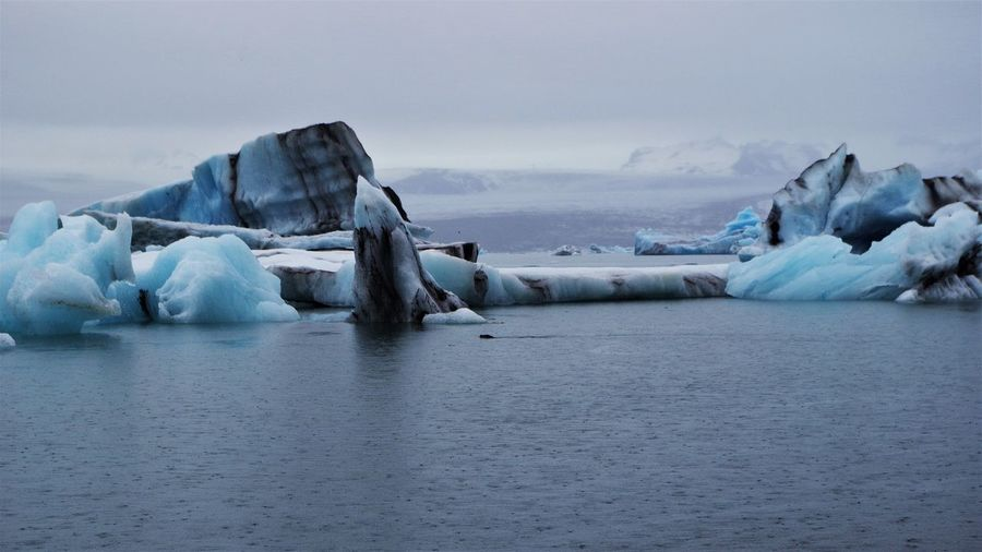 Magnificent Iceberg at Jökulsarlon Glacier Lagoon in southern iceland. Beauty In Nature Cold Temperature Day Floating On Water Frozen Glacier Ice Iceberg Iceberg - Ice Formation Nature No People Outdoors Scenics Sea Sky Tranquil Scene Tranquility Water Waterfront Winter