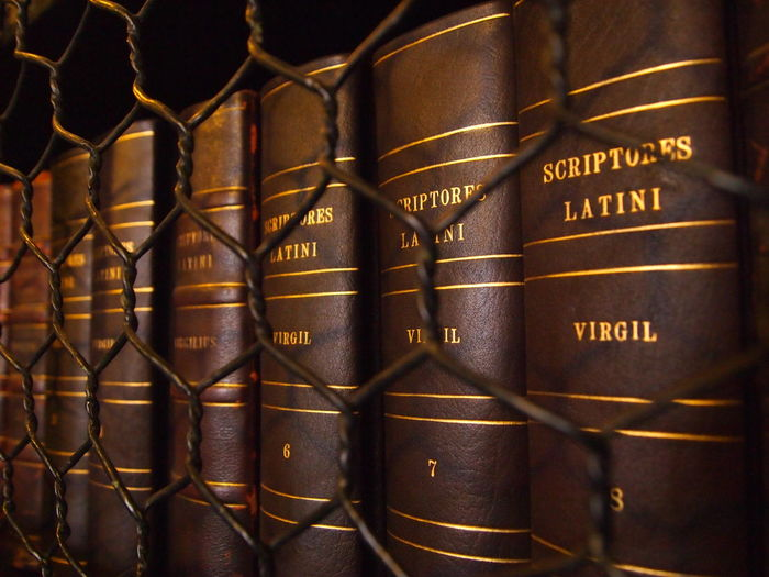 In a library in Manchester Book Detail Education Information Latin Library Metal No People Reading & Relaxing Real People Selective Focus Vintage Vintage Book Virgil