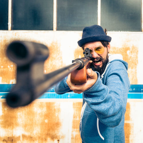 Agressive Angry Gun Hunter Man Shoot Square Stripes Target Airgun Beard Front View Hat Hipster Hunt Hunting Jumpsuit One Person Onsie Pose Pyjama Riffle Threatening Waist Up Weapon The Portraitist - 2018 EyeEm Awards