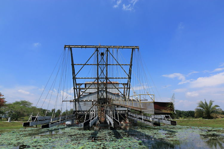 the last tin ore dredger in Perak Hoisting Crane Machines Perak Blue Sky And Clouds Day Dredger Ship Mining Industry Mining Town No People Outdoors Tanjung Tualang Tin Mine Tin Ore Water Sky Architecture Built Structure Nature Blue Nautical Vessel
