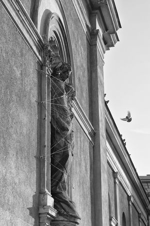 Secretive Day Dolefulness Fixed Locked Mournful No People Old Buildings Outdoors Sad Sadness Sealed Statue Statue In The City Telling Stories Differently Tied The Architect - 2016 EyeEm Awards
