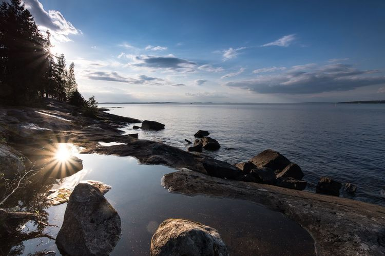 Beauty In Nature Calm Cloud Cloud - Sky Horizon Over Water Idyllic Lens Flare Nature No People Outdoors Reflection Remote Rock Rock - Object Rock Formation Scenics Sea Sky Sun Sunbeam Sunlight Sunset Tranquil Scene Tranquility Water