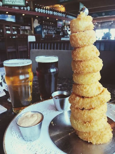 Onion ring tower Oregon Coast Pelican Brewery Pelican Yummy Vacations Resturant Relaxing Moments Eyemphotography IPhoneography Interesting Shots Food And Drink Freshness Food Drink Still Life Refreshment Table Indoors  No People Beer Beer - Alcohol Drinking Glass Close-up Indulgence Ready-to-eat Household Equipment Alcohol Glass