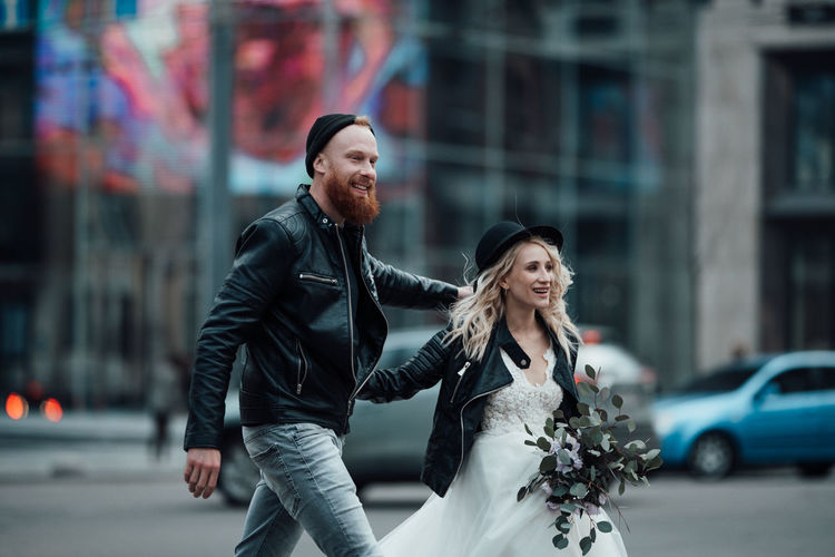 Young couple on street in city