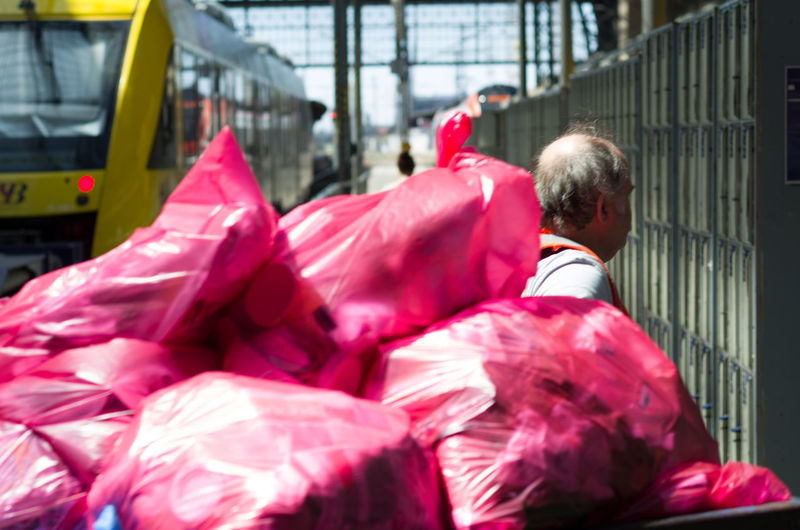 Work Day Men One Person Pink Color Real People Rear View Red Senior Adult Trashbags Waist Up