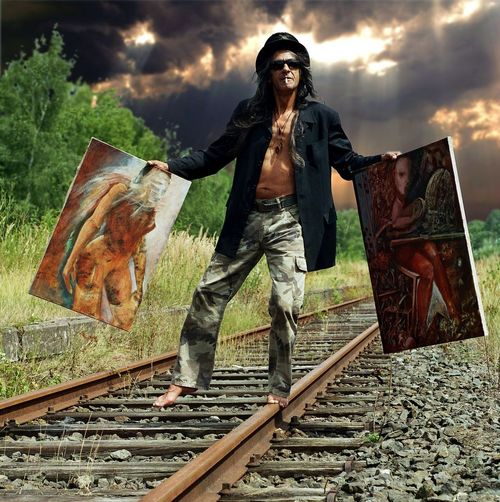 art is always at the edge Art Photography Artist At The Edge Dramatic Sky Fine Art Photography Paintings Smoking Art Artist Portrait Balance Camouflage Pants Crazy Fine Art Insane Over The Edge Portrait Portrait Man Rail Railway Surreal Surrealism Top Hat Wacko