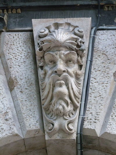Building Feature, Andrassy Street Andrássy Street Architectural Feature Architecture Bas Relief Budapest Building Exterior Building Feature Capital City Carved Face. Close Up Composition Face Full Frame Fun Gsrgoyle Hungary Low Angle View No People Outdoor Photography Sculpture Stone Carving Travel Destination