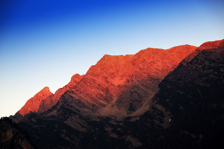 Sunrise alpine landscape Sky Mountain Beauty In Nature Tranquil Scene Clear Sky Tranquility Scenics - Nature Rock Nature No People Mountain Range Rock - Object Physical Geography Geology Solid Non-urban Scene Rock Formation Copy Space Idyllic Day Outdoors Formation Mountain Peak Eroded Arid Climate
