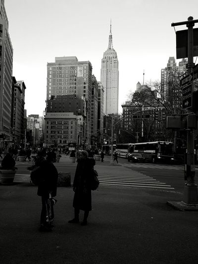 Darkness on the edge of town. City Street City Skyscraper City Life Urban Skyline Full Length People Street Building Exterior Cityscape Day Built Structure Architecture Downtown District 23rd Street  Outdoors Black And White Photography Monochrome Black And White Black & White Black&white EyeEm Best Shots - Black + White New York City Welcome To Black
