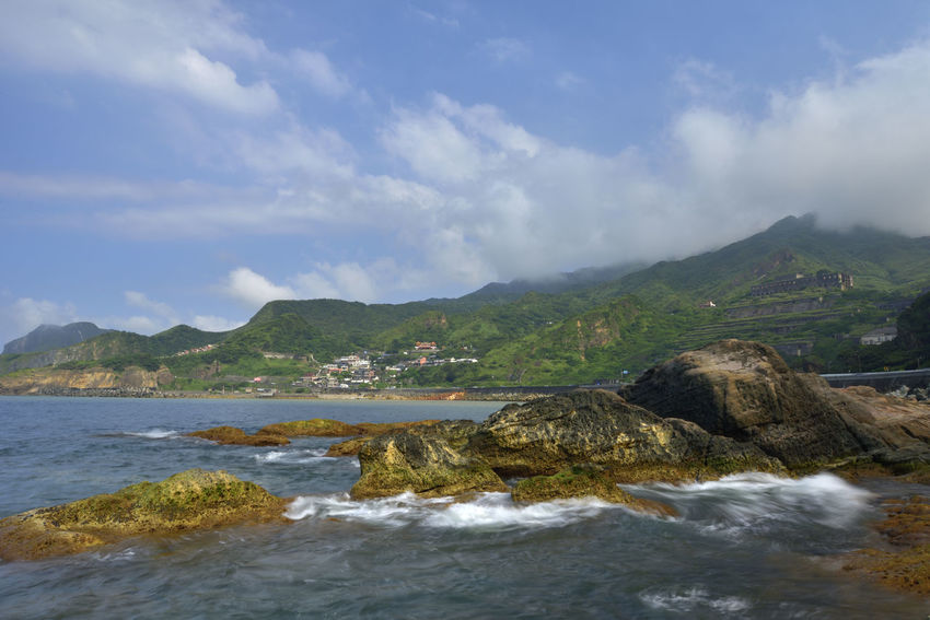 The northeast corner of Taiwan's New Taipei City is a scenic spot suitable for sightseeing. Jinguashih Northeast Coast Ruifang, New Taipei Taiwan Beach Beauty In Nature Cloud - Sky Day Land Motion Mountain Mountain Range Nature New Taipei City No People Outdoors Rock Rock - Object Scenics - Nature Sea Sky Solid Tranquil Scene Tranquility Water