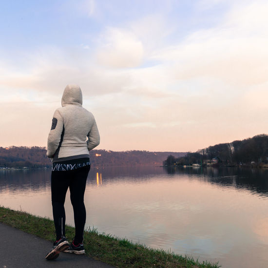 Baldeney Babe - shot at Baldeneysee in Essen, Germany EyeEm Best Shots Adult Adventures In The City Beauty In Nature Casual Clothing Cloud - Sky Full Length Girl Hood - Clothing Lake Leisure Activity Lifestyles Looking At View Nature One Person Outdoors Real People Rear View Scenics - Nature Sky Standing Tranquility Warm Clothing Water