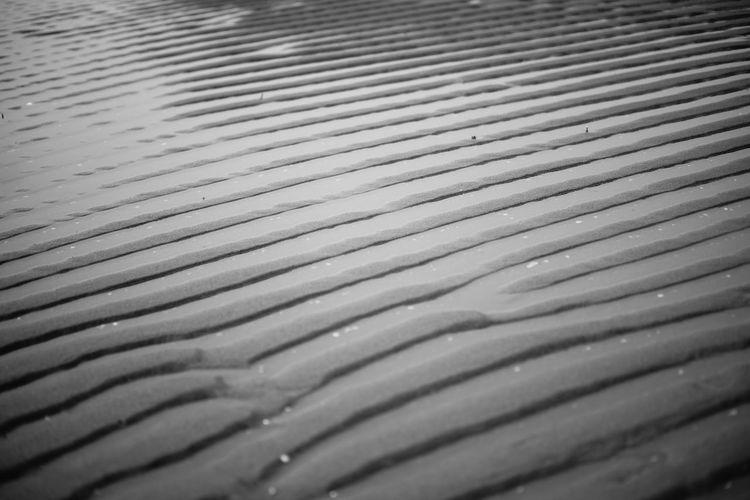 beach sand when receding Backgrounds Pattern Textured  Water Sandy Beach Nature Wet Receding