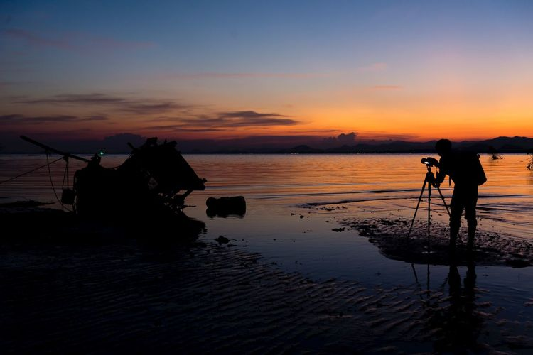 Take a photo after the sun down Water Sky Sunset Sea Beach Land Silhouette Reflection Beauty In Nature Nature Men Scenics - Nature Activity Cloud - Sky Adult Lifestyles Outdoors Photographer My Best Travel Photo