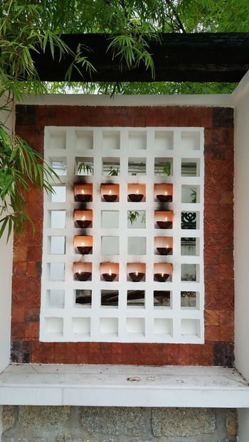 Day Outdoors No People Grid Pattern Lights Light And Shadows Candle Flame Wall Art Wall Decoration Wall - Building Feature Candle Lighting  Candles Burning