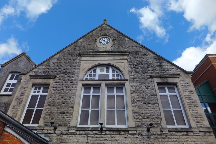 Looking up Blue Sky Art Centre Swindon Old Town Clock