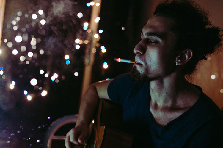 Back Lit Christmas Lights Cigarette  Guitar Handsome Holding Illuminated Indoors  Light Lights Night Person Playing Portrait Portrait Of A Friend Smoke Smoking Well-dressed Young Adult Young Men Enjoy The New Normal