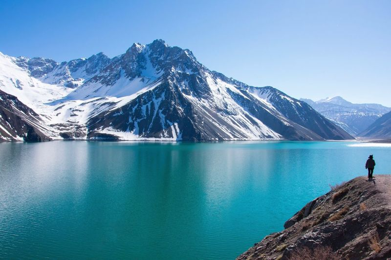 Mountain Nature Scenics Beauty In Nature Tranquil Scene Tranquility Chile Santiago Embalse El Yeso Latin America Sky Mountain Range Snow Water Cold Temperature Blue Winter Day Outdoors Adventure Snowcapped Mountain One Person Lake Clear Sky Physical Geography Perspectives On Nature