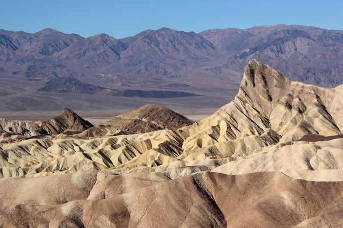Geology Scenics Nature Tranquility Tranquil Scene Arid Climate Physical Geography Beauty In Nature Desert Extreme Terrain Non-urban Scene Landscape Remote Mountain Outdoors Day Mountain Range No People My Year My View Zabriskie Point Death Valley Death Valley National Park Landscapes Tourism Miles Away