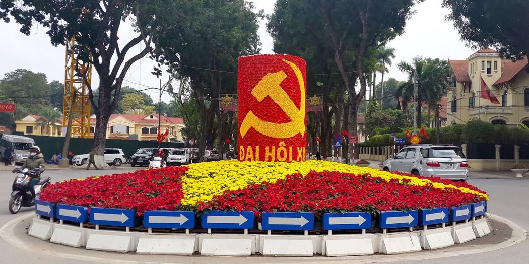 Vietnam Street Photography Hanoi, Vietnam Red Yellow Roundabout Art Roundabout Flower Art Flowers Middle Of The Road Communism