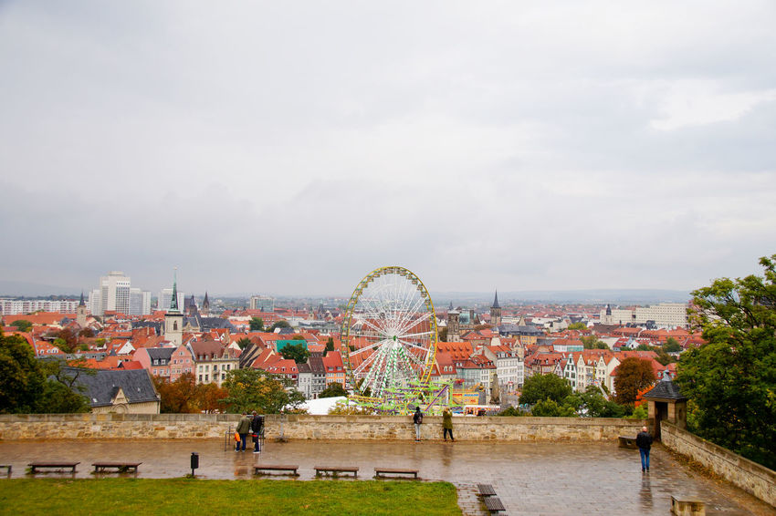 Cityscape Dom Jahrmarkt Postcode Postcards Rethink Things Second Acts Adult Amusement Park Amusement Park Ride Arts Culture And Entertainment Building Exterior Built Structure Day Dome Ferris Wheel Group Of People Large Group Of People Leisure Activity Men Nature Outdoors People Sky Tree