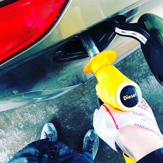 Human Body Part Personal Perspective Car Real People High Angle View Human Hand One Person Transportation Day Outdoors Low Section Men Close-up One Man Only People Adult Fuel Pump Fuel Diesel