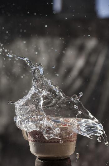 Close-up of ice splashing water