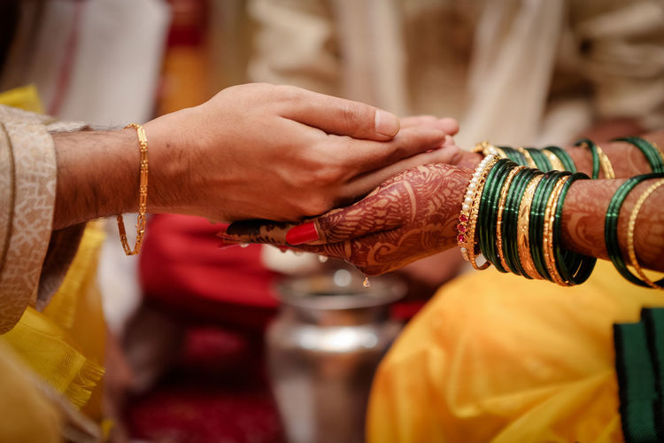 Cropped Hands Of Couple During Wedding Ceremony