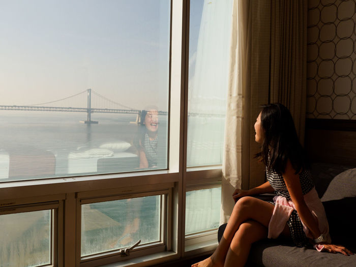 Busan,Korea Gwangalli Beach Gwangalli Bridge Gwangan Bridge Gwangandaegyo Bridge Happiness Korea Laughing Looking Out Of The Window Morning Morning Light Travel Busan Hotel Hotel Room Hotel Room View Laugh Lifestyles Looking Through Window Nature Sea Sea And Sky Sitting Window Young Women