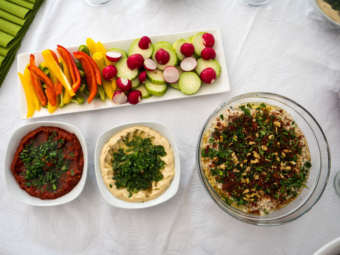 A mix of arabic food together with fresh vegetables Kibbe Arabic Arabic Food Choice Dinner Food Food And Drink Freshness Glass Healthy Eating Indoors  Kobbe Meal Mutabbal Plate Ready-to-eat Serving Size Table Temptation Tomato Tray Variation Vegetable Vegetarian Food Wellbeing