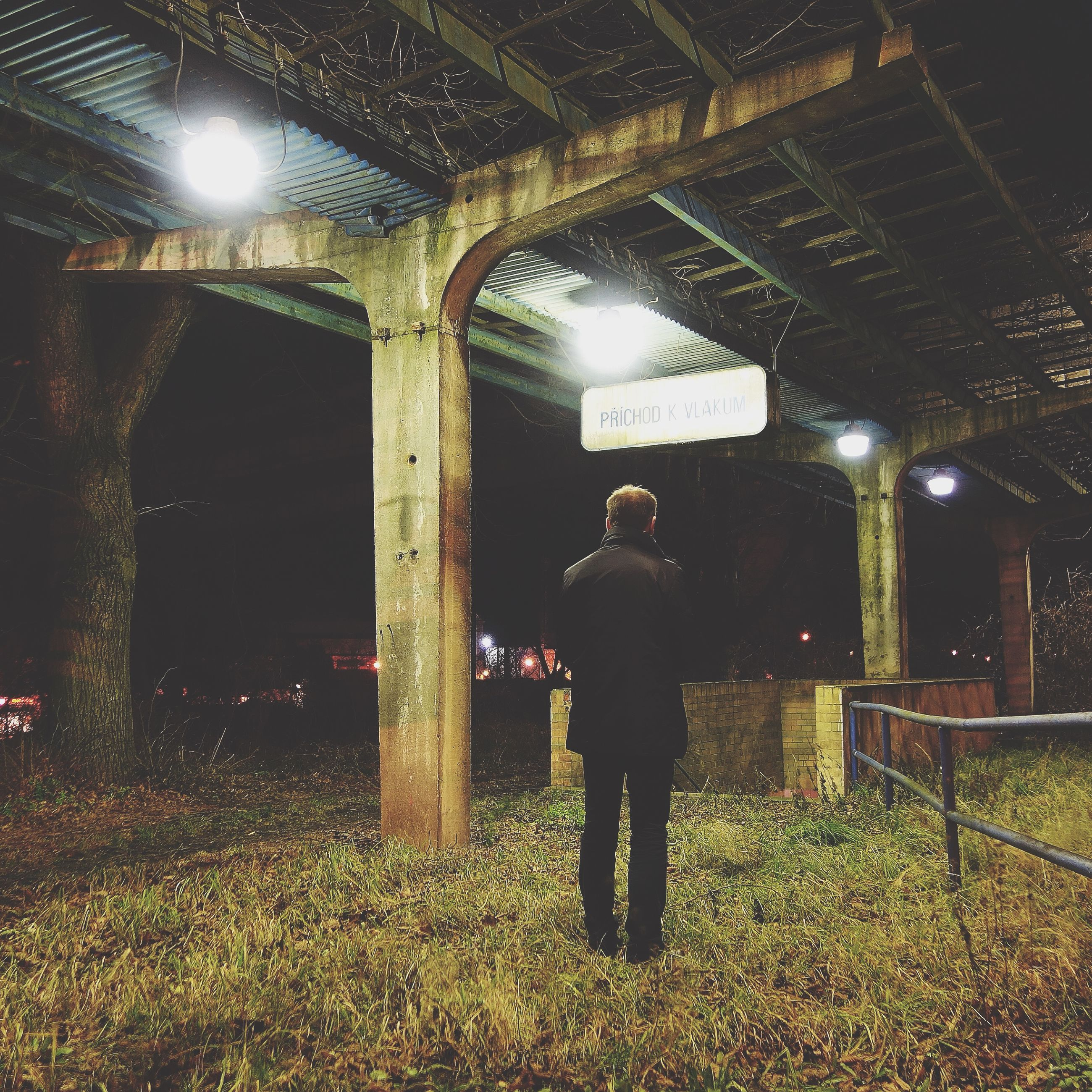 lifestyles, standing, full length, rear view, architecture, leisure activity, casual clothing, built structure, night, illuminated, men, indoors, building exterior, arch, walking, three quarter length, person, grass